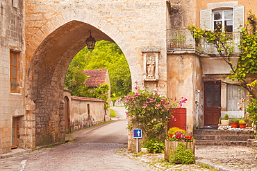 One of the old gates to the village of Noyers sur Serein in Yonne, Burgundy, France, Europe
