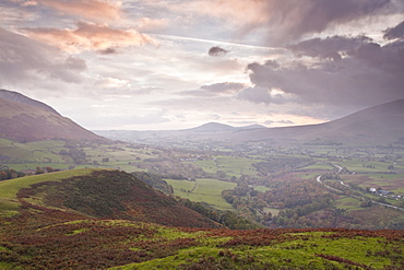 Rain clouds battle with the sunrise over the Lake District near to Keswick, Cumbria, England, United Kingdom, Europe