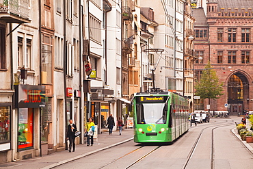 A tram runs down the streets of Basel in Switzerland, Europe