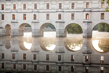 The chateau of Chenonceau, UNESCO World Heritage Site, reflecting in the River Cher at sunrise, Indre-et-Loire, Centre, France, Europe