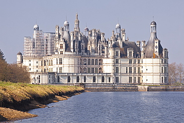 The beautiful 16th century Chateau de Chambord, UNESCO World Heritage Site, across the waters of the canal in front of it, Chambord, Loir-et-Cher, Centre, France, Europe