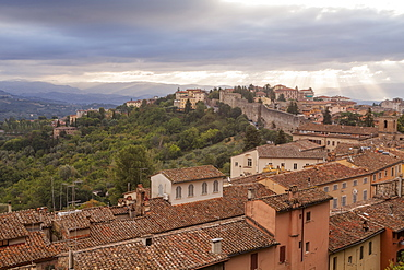 Storm clouds clearning over Perugia's historic centre, Perugia, Umbria, Italy, Europe