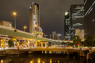 High rise office buildings in the Dotonbori area of Osaka at night, Osaka, Japan, Asia