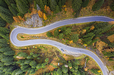 A view by drone of a winding road in the Dolomites, Veneto, Italy, Europe