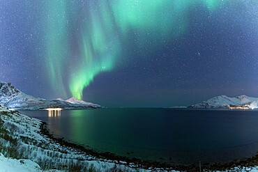 The Northern Lights (aurora borealis) lighting up the sky near Tromso, Norway, Scandinavia, Europe