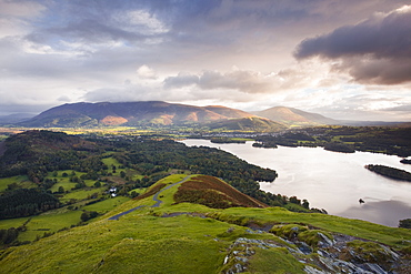 The rising sun lights up the fells of Skiddaw and Blencartha, Lake District National Park, Cumbria, England, United Kingdom, Europe