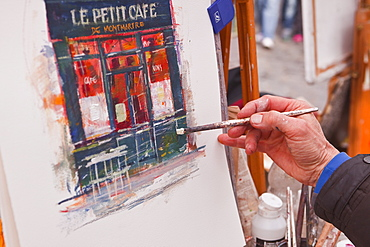 A street artist at work in the famous Place du Tertre in Montmartre, Paris, France, Europe