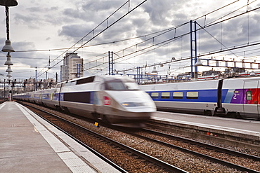 A high speed TGV train arrives at Gare Montparnasse in Paris, France, Europe