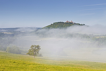 Mist clears away from around the hilltop village of Vezelay in the Yonne area of Burgundy, France, Europe