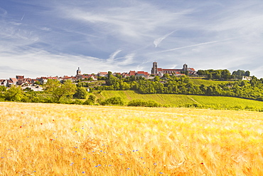 A wheat field below the hilltop village of Vezelay in the Yonne area of Burgundy, France, Europe