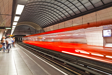 A train pulls out of a station on the Lyon metro system, Lyon, Rhone, Rhone-Alpes, France, Europe