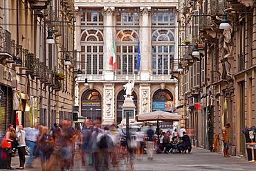 A bustling Via Giuseppe Garibaldi with Palazzo Madama at the end, Turin, Piedmont, Italy, Europe