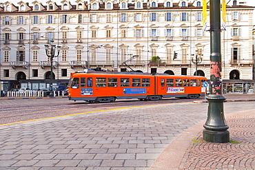 A tram trundles through Piazza Castello, Turin, Piedmont, Italy, Europe