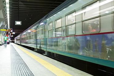 A train pulls into Porta Susa railway station, Turin, Piedmont, Italy, Europe