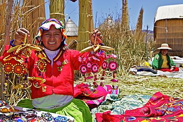 Portrait of a Uros Indian woman selling souvenirs, Islas Flotantes (Floating Islands), Lake Titicaca, Peru, South America