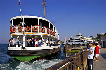 Ferry and fisherman on the Bosphorus, Istanbul, Turkey, Europe, Eurasia