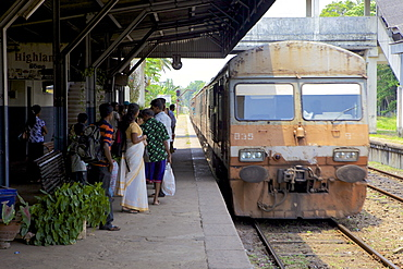 Train arriving at Negombo train station, Sri Lanka, Indian Ocean, Asia