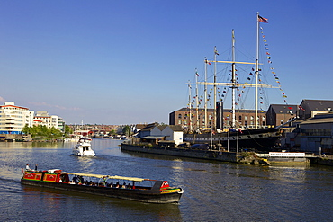 Boats passing the SS Great Britain in Bristol Floating Harbour, Bristol, England, United Kingdom, Europe