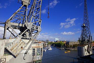 Bristol's floating harbour and an old Dockside crane, Bristol, England, United Kingdom, Europe