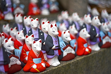 Small fox figurines as marriage votives, Fushimi Inari shrine, Kyoto, Japan, Asia