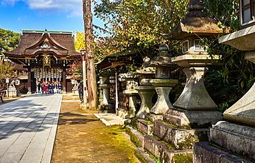 Stone lanterns at the entrance to the Kitano Tenmangu Shrine, Kyoto, Japan, Asia