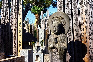 Buddah and wooden Toba tablets (memorial tablets) in a Japanese graveyard at Kyoji Buddhist Temple in Yanaka, Tokyo, Japan, Asia