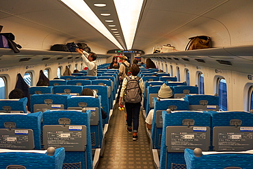 Passengers on a bullet train in Japan, Asia