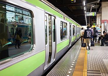A Tokyo subway train at a station, Tokyo, Japan, Asia