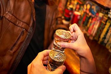 Drinking saki (sake) in Golden Gai, Tokyo, Japan, Asia