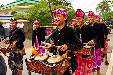 Musicians leading a traditional Sasak wedding procession, Lombok, Indonesia, Southeast Asia, Asia