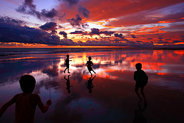 Children play at the Saint Martin's Island, locally known as Narkel Jinjira,  Bangladesh