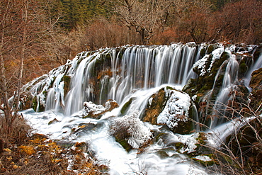 Nuorilang waterfall at Jiuzhaigou valley National Park, Sichuan Province, China. Jiuzhaigou (Nine-Village Gully) is a scenic spot in the northern part of Sichuan Province, China