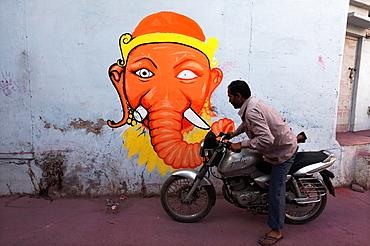 Motorcyclist and modern representation of Ganesh, Rajasthan India