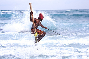 Stilt fisherman near the beach, traditional fishing, Weligama, Indian Ocean, Sri Lanka