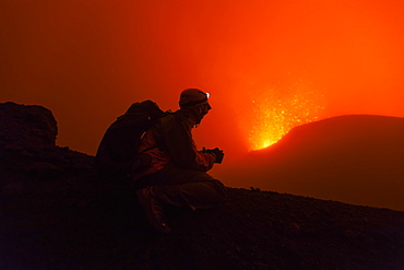 Volcanologist on Piton de la Fournaise in activity, Volcano eruption of May 2015, Reunion