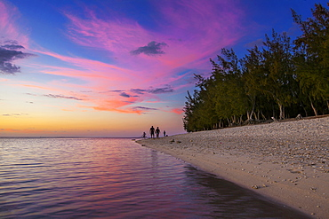 Family walk at sunset on the beach of l'Ermitage, La Reunion Marine Nature Reserve, Indian Ocean