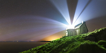 A home-built lighthouse at Pointe du Muller. Its light beams do not turn, but flash. They spread in the atmosphere in large light beams.