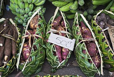 Baskets of sweet potato (Ipomea batatas) on the market of Port Vila, Efate Island. Vanuatu.