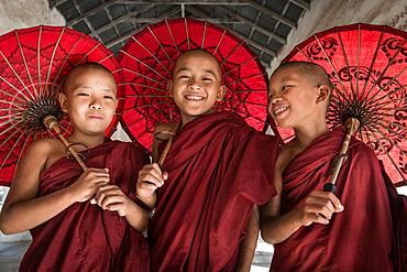 Teen Buddhist monks in Burma in Bagan city in Sweshigone pagoda