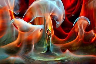 Burning drop, drop of water falling into benzine