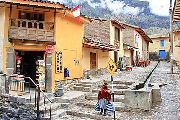 Street of downtown Ollantaytambo, Peru. Village known to have kept its ancient system of water flow.