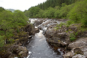 Waterfall and Pot hole in rock outcrop, River Orchy, Allt Broighleachan, Argyll, Scotland