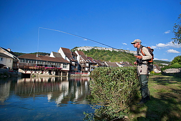 Fly fishing on the Loue river, Ornans, Doubs, Franche-Comté, France