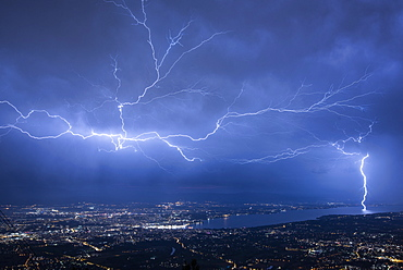 Lightning runing in the sky and impact near Saint-Julien en Genevois during the thunderstorm of the 2019, 25th july 2