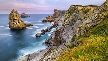 Twilight on the Cantabrian coast. Needles of Liencres, near Santander, Spain