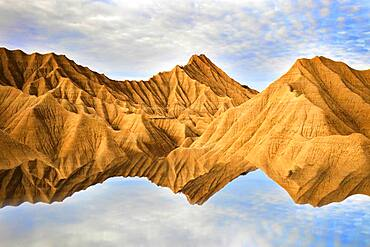 Reflection of the sand mountains in Bardenas Reales, Navarra, Spain