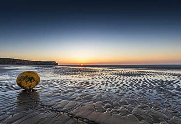 Buoy at low tide on Sangatte beach, Hauts de France, France