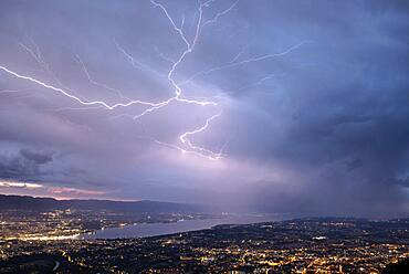 Thunderstorm of July 25, 2019 in Geneva. Lightning crawling on the sides of a cumulonimbus overlooking Geneva. Shooting from Mont Sal?ve. Haute-Savoie, France