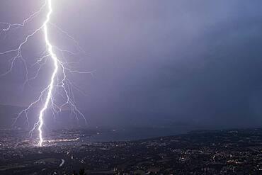 Lightning strike in Geneva during the storm on July 25, 2019. Shooting from Mont Sal?ve, 1000m above Geneva. Haute-Savoie, France