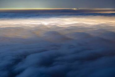 Sea of night clouds, lit by Aix les Bains and Chamb?ry. Stratus on the Savoyard valleys, during a marked temperature inversion. Shooting from Mont Revard. Savoy, France
